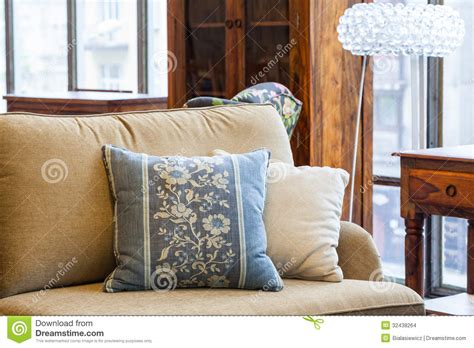 brown sofa with blue pillows blue and cream pillows stock images image 32438264