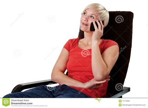 woman in armchair woman in armchair calls on mobile stock images image