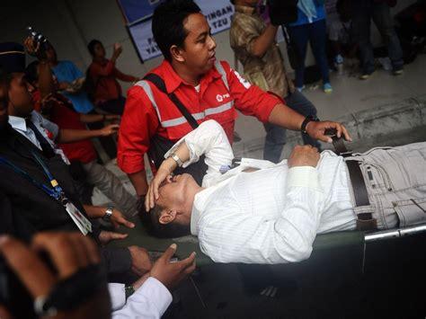 airasia news today relatives of airasia jet passengers despondent over grim