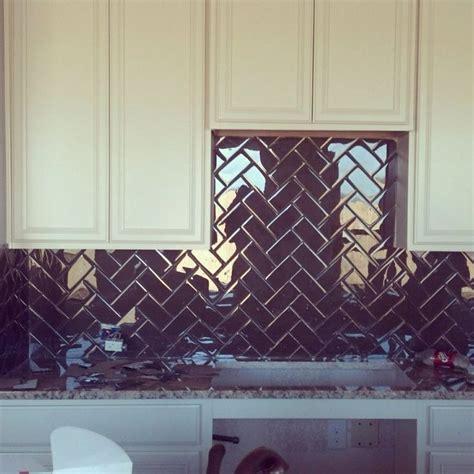 Glass subway tile backsplash in herringbone pattern