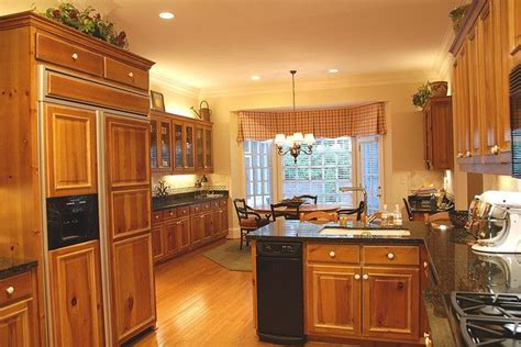 is it hard to paint kitchen cabinets love this keep my cabinets oak paint walls yellow paint