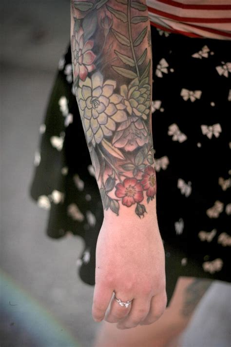 lower arm tattoo succulents and roses by carrier at