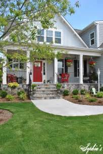sophia s farmhouse style front porch with pops of red