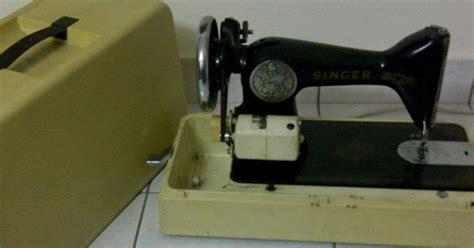 Mesin Jahit Mudah Alih Singer gerobok yang ada macam macam benda mesin jahit singer