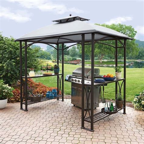 picture of metal gazebo with shelves on the sides