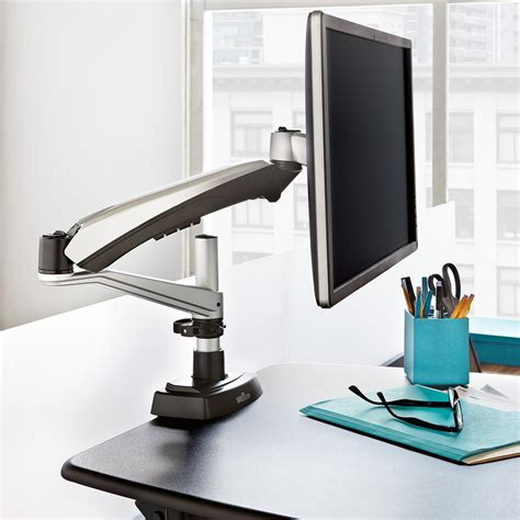stand at your desk varidesk standing desk monitor arms let you position your