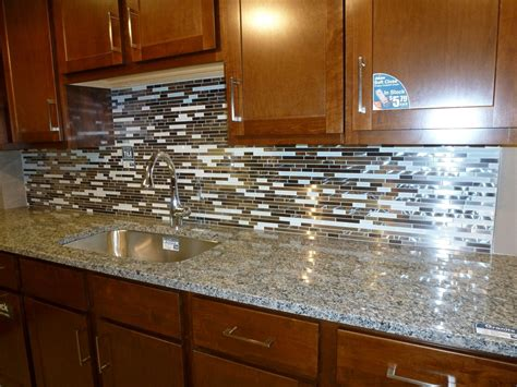 pics of kitchen backsplashes glass tile kitchen backsplashes pictures metal and white glass random strips backsplash tile