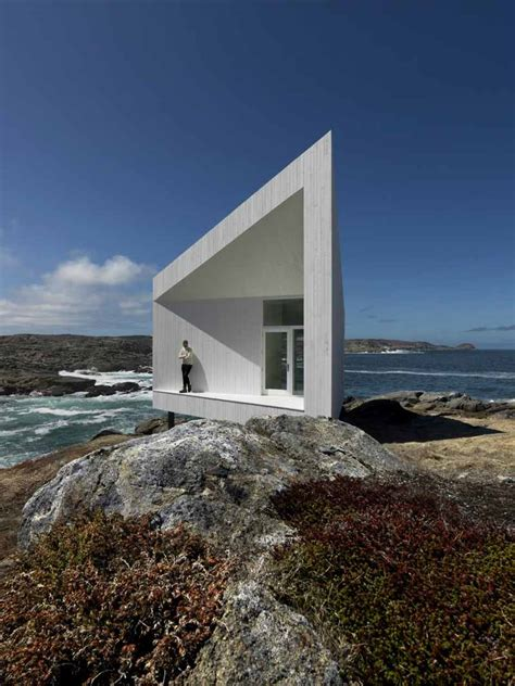 small and modern studio on a rocky cliff with view squish studio home building