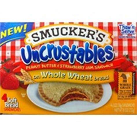 whole grain uncrustables smucker s uncrustables pb strawberry jam sandwich on