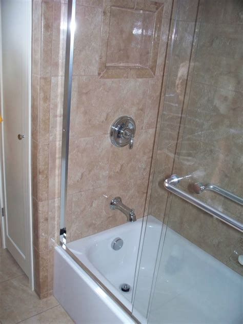 Tub And Shower Doors How A Small Outdated Bathroom Was Transformed Into Feeling Like A Hotel