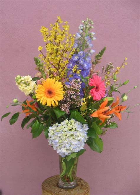 forsythia makes this lovely arrangement flowers pinterest