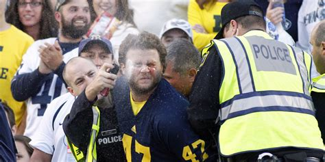 michigan fan maced in face during football game against