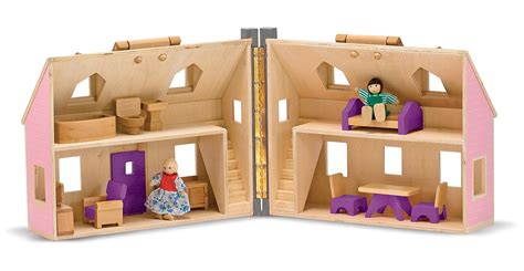 amazon doll houses amazon com melissa doug fold and go wooden dollhouse with 2 dolls and wooden