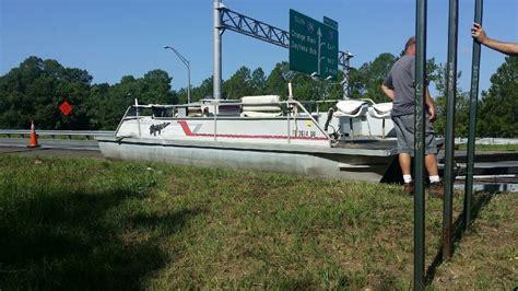 driving boat onto trailer boat falls off trailer onto i 295 northbound