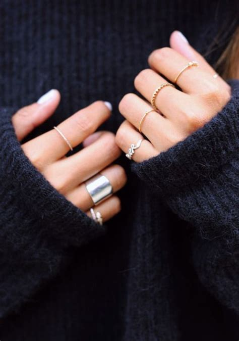 rings on every finger styled with a cozy black sweater