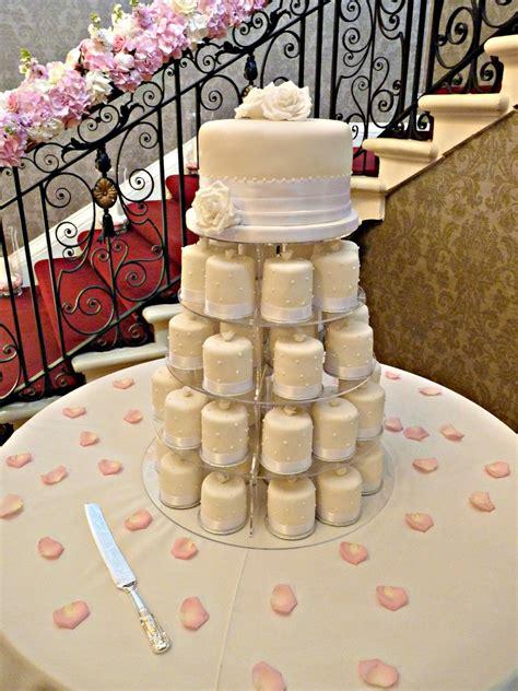 miniature cakes and wedding cake 60 miniature cakes plus a ivory mini cakes cakecentral com