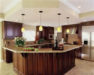 Kitchen Cabinets And Islands luxury kitchen with cherry cabinets and a large angular island bar