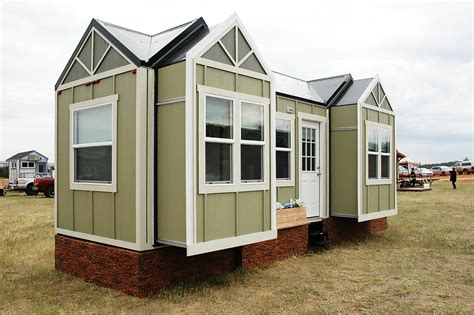 expandable tiny house unconventional tiny home for the road expands with the
