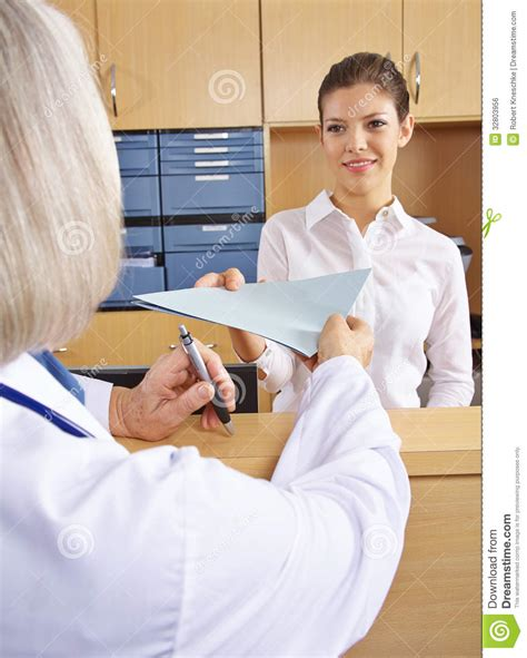 Hospital Receptionist by Doctor Getting Records In Hospital Royalty Free Stock Image Image 32803956