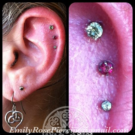 black hole body piercing and tattoo outer helix piercing done with pushpins and prong