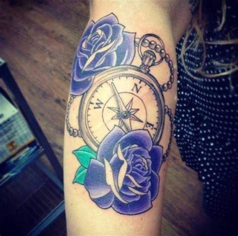 chain of roses tattoo blue roses compass and chain tattooed