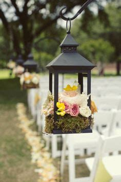 Wedding Aisle With Shepherds Hooks by Wedding Flowers Centerpieces Bouquet On Plum