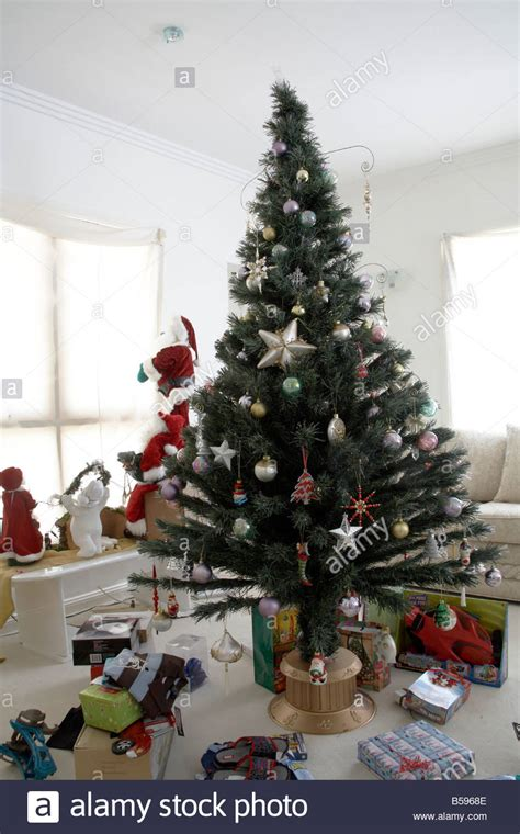 christmas tree with decorations and presents in daytime