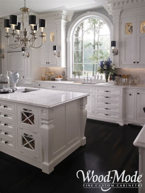 Greenfield Kitchen Cabinets by Creamy White Cabinets Black Countertops Carrera