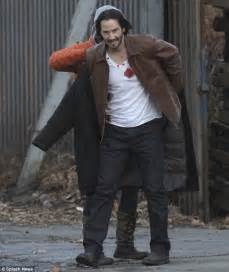 what tattoo does john wick have on his back new pictures of keanu reeves on the set of john wick