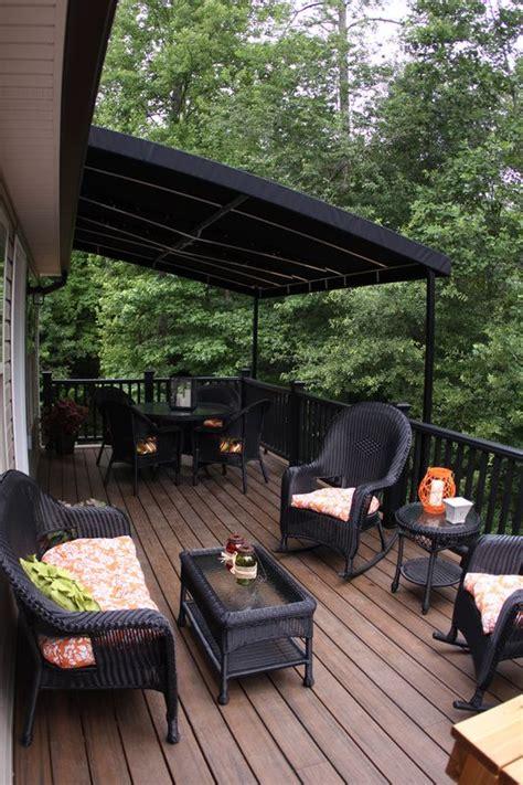 love  dark stain  deck flooring  black railing