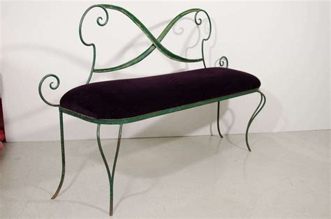 small italian green metal bench with purple velvet seat at