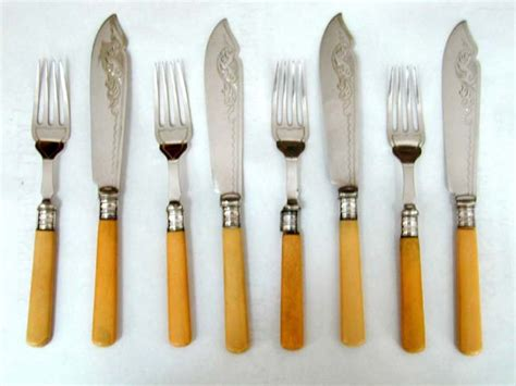 Kalung Vintage Brass Bone Collector Fishbone a antique set of bone handled fish fork and