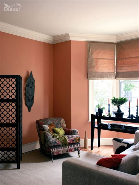 terracotta walls living room i m thinking of this for the chimney breast and a lighter white shade for the other walls