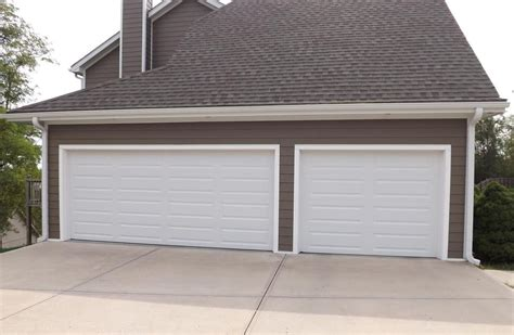 Independence Overhead Door Premium Series Clopay Garage Doors To Complete Exterior Remodel By Christian Brothers Roofing