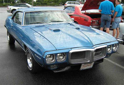 1969 pontiac firebird 400 coupe vs 1969 dodge charger r t se cool rides online