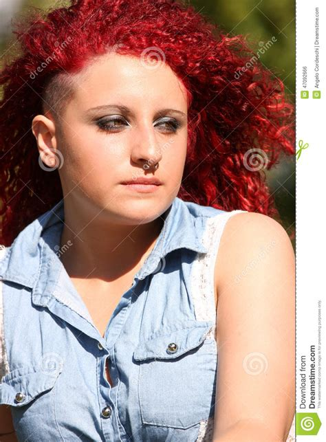 portrait   young girl  red curly hair  piercing
