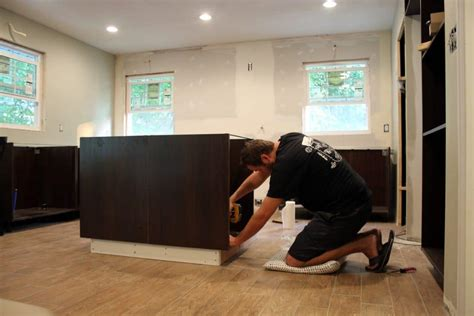 putting   installing  ikea sektion cabinets chris loves julia