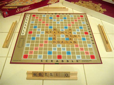 scrabble board picture perfumed by b christo christi and a of monopoly