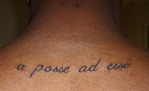 Latin Neck Tattoo | latin quote tattoo on neck busbones