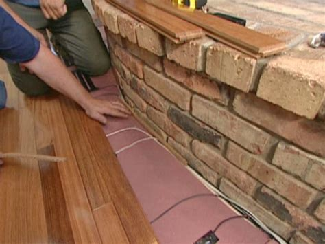 Installing Hardwood Floors Next To Existing Hardwood How To Install Flooring Around A Fireplace How Tos Diy