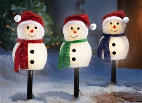 holiday time 4 piece vintage snowman pathway christmas lighted lawn stakes set pathways markers and snowman on