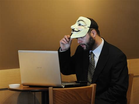 group pledges to release more info on hacking team attack anonymous hackers on isis war business insider