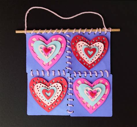 Quilt Paper Craft - hanging hearts cut paper quilt craft crayola