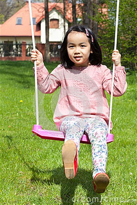 swinging in asia asian girl swinging in a garden stock photo image 40882764