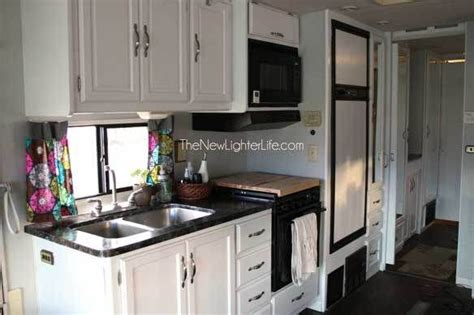 painting faux wood real wood cabinets and paneling in an