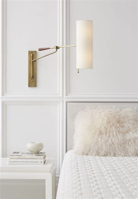 aerin lauder visual comfort bedroom lighting design brass wall sconces circa