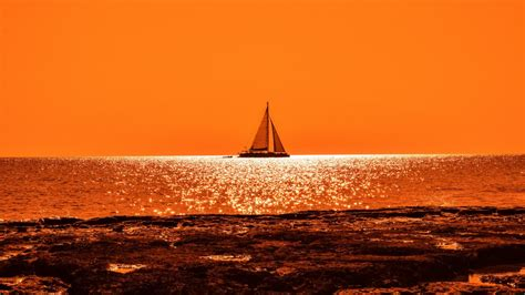 yacht wallpaper 4k sunset boat sail 4k wallpapers hd wallpapers id 22028