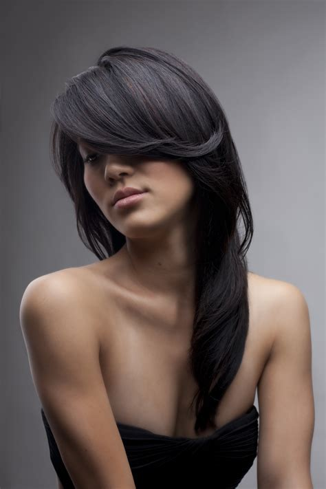 blowdrying a shag haircut long dark hair with layers layers bangs dark hair