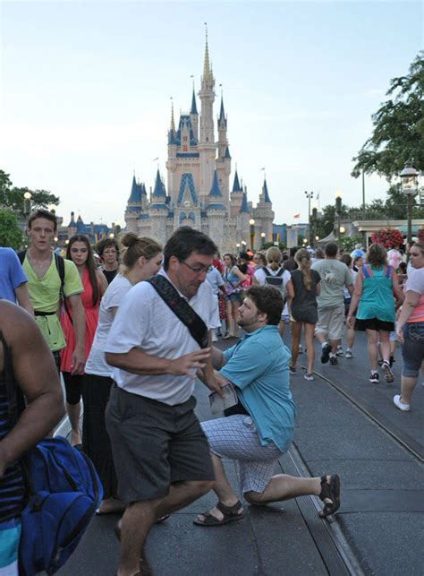 guy photo bombs wedding proposal  disney world