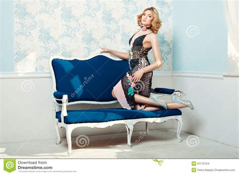 standing on the couch girl standing knees on the couch stock photo image